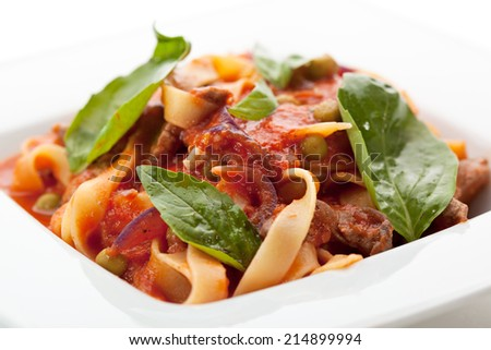 Pasta with Meat, Tomato Sauce and Basil Leaf - stock photo