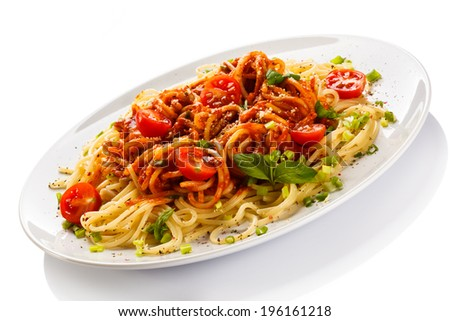 Pasta with meat, tomato sauce and vegetables - stock photo