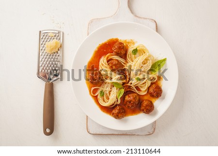 Pasta with meatballs and basil with tomato sauce - stock photo