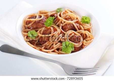 Pasta with meatballs and tomato sauce on white background - stock photo
