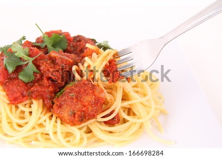 Pasta with meatballs being eaten with a fork - stock photo