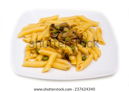 Pasta with mushrooms and peas on white background - stock photo