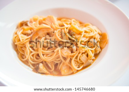 Pasta With mushrooms On White Plate. - stock photo