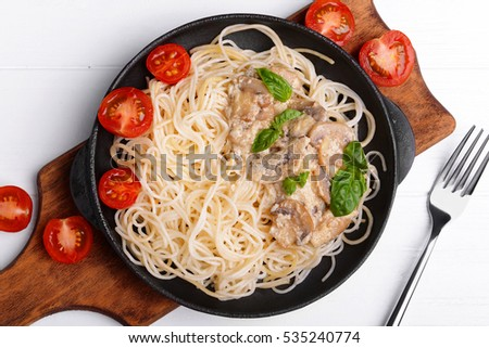 Pasta with mushrooms sauce in pan, top view