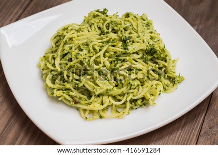 Pasta with pesto Brazilian. Wooden table
