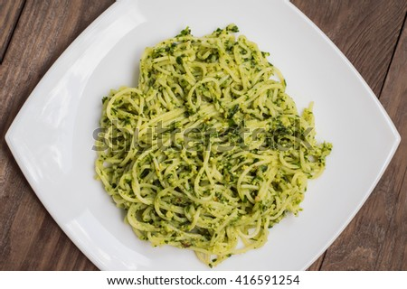 Pasta with pesto Brazilian. Wooden table. Top view