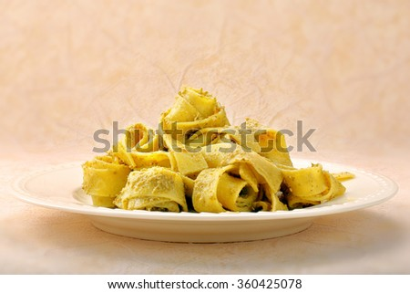 Pasta with pesto on a plate