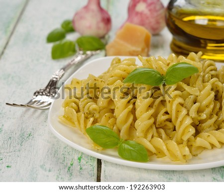 Pasta with pesto on white background closeup