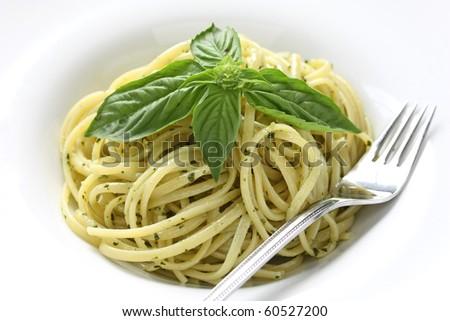 Pasta with pesto sauce - stock photo