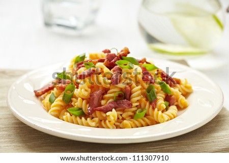 Pasta with pumpkin and bacon - stock photo