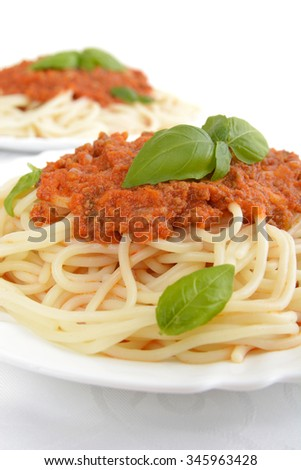 Pasta with ragu a'la bolognese on white background,cropped shot - stock photo