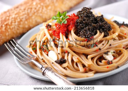 pasta with red and black lumpfish roe - stock photo