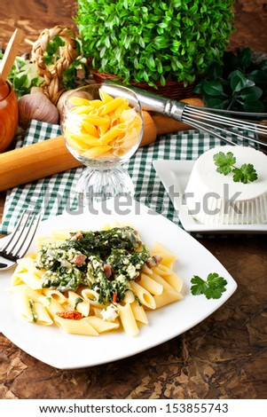 Pasta with ricotta and spinach on complex background