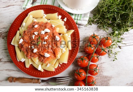 Pasta with ricotta sauce, tomatoes and ham - stock photo