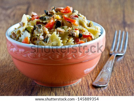 pasta with salad and red tomatoes - stock photo
