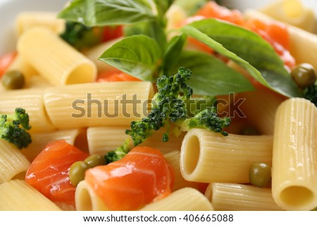 Pasta with salmon and broccoli closeup - stock photo