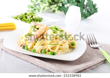 Pasta with salmon and peas on complex background