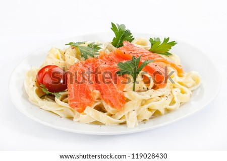 pasta with salmon on a plate - stock photo