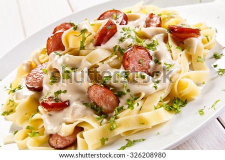 Pasta with sausages and vegetables  - stock photo