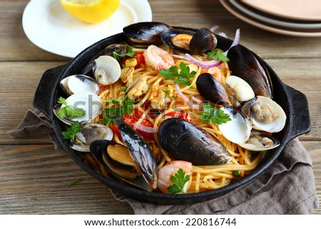 Pasta with seafood in a pan, nutritious food - stock photo
