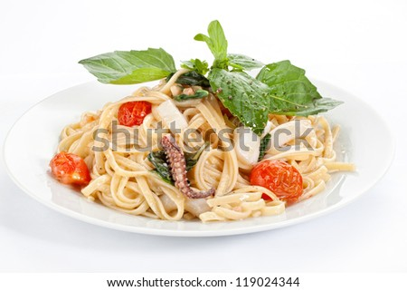 pasta with seafood on a plate - stock photo