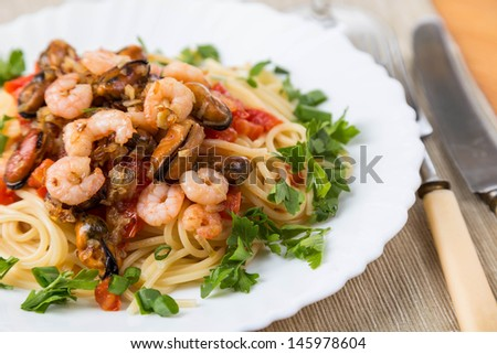pasta with seafoods and white wine on napkins - stock photo