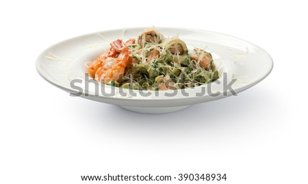 Pasta with shrimps and salmon. Front view. - stock photo