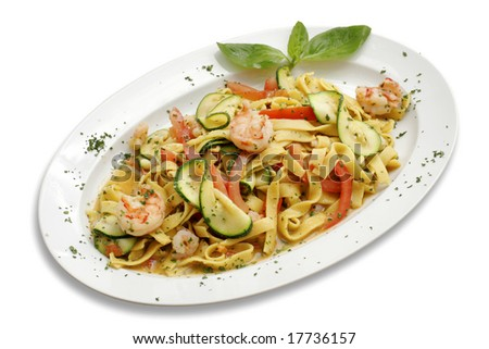 Pasta with shrimps and zucchini. Italian kitchen. White isolated with path.