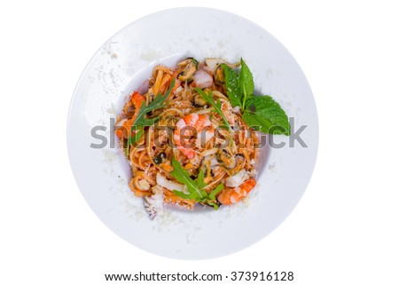 Pasta with shrimps, mussels, squid and parmesan cheese, top view, isolated - stock photo