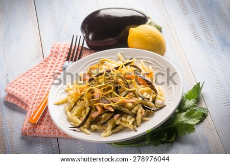 pasta with smoked salmon, eggplant and lemon peel - stock photo