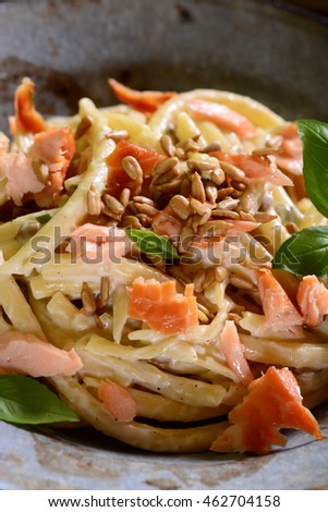 Pasta with smoked salmon, gorgonzol and roasted sunflower seeds