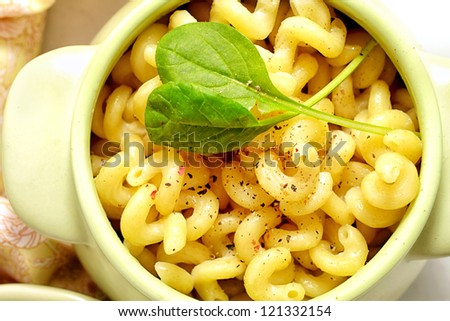 Pasta with spices in a clay pot - stock photo