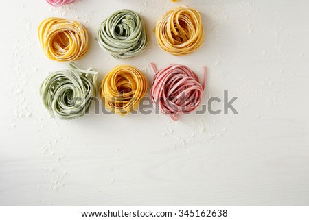 pasta with spinach and beetroot, top view - stock photo