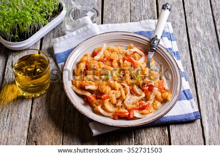 Pasta with squid and vegetables, sprinkled with bread crumbs, in a rustic style. Selective focus.