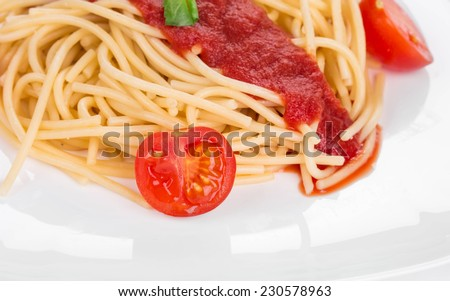 Pasta with tomato and basil. Isolated on a white background.