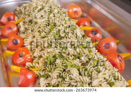 Pasta with tomato and herbs on display at a hotel restaurant buffet - stock photo