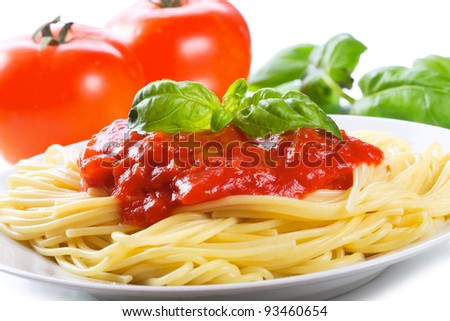 Pasta with tomato sauce and basil - stock photo