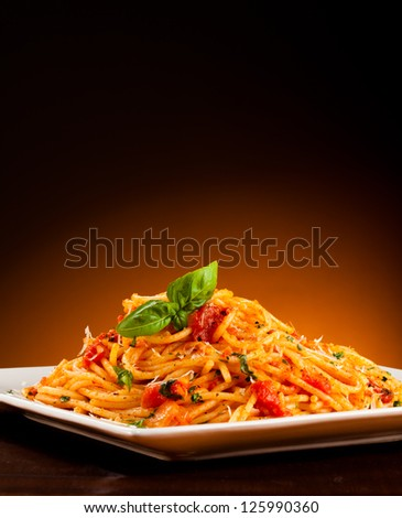 Pasta with tomato sauce and parmesan - stock photo