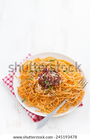 pasta with tomato sauce and parmesan on white wooden background, top view, vertical - stock photo
