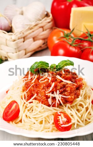 Pasta with tomato sauce beef bolognese on a wooden table - stock photo