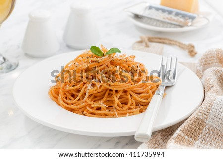pasta with tomato sauce on a white plate, horizontal