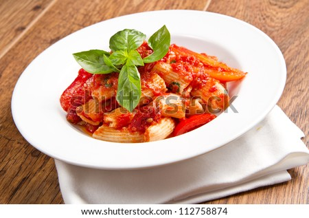 pasta with tomatoes and basil - stock photo