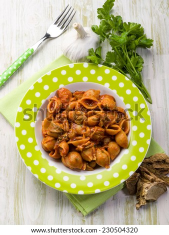 pasta with tomatoes and dried cep mushroom - stock photo
