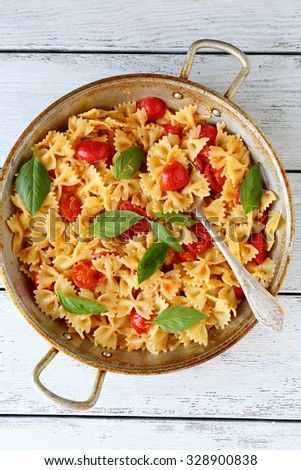 pasta with tomatoes in pan, food top view - stock photo