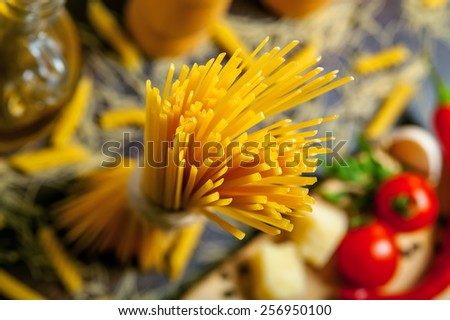 Pasta with tomatoes, parmesan cheese, garlic and pepper - stock photo