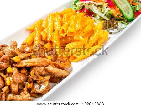 pasta with vegetables, meat, and corn drizzled with sauce in dish on white background - stock photo