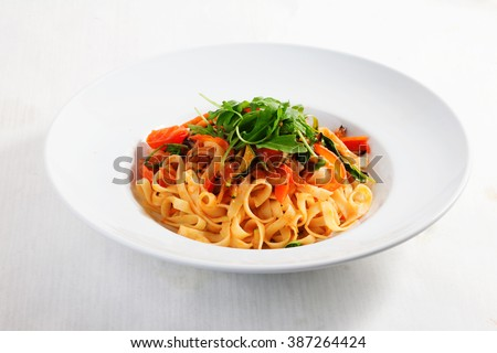 pasta with vegetables, tomatoes, zucchini, peppers, isolated on white background tomato sauce Round plate menu cafe restaurant - stock photo