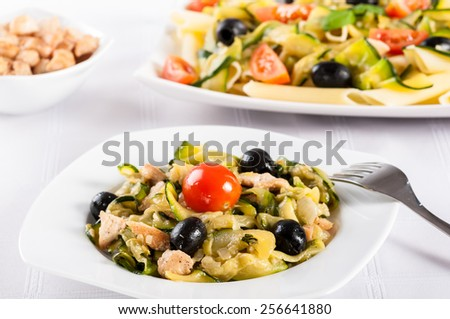 pasta with vegetables: zucchini, olives, tomatoes