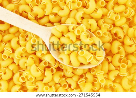 Pasta with wooden spoon background