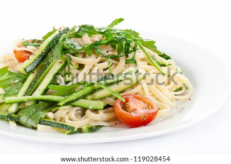 pasta with zucchini on a plate - stock photo